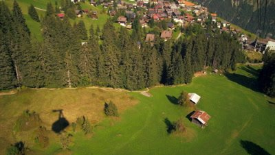 Dolly shot of Swiss village as tram descends from the mountain