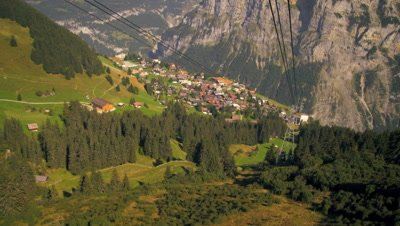 Aerial dolly shot of a small village near the Swiss alps