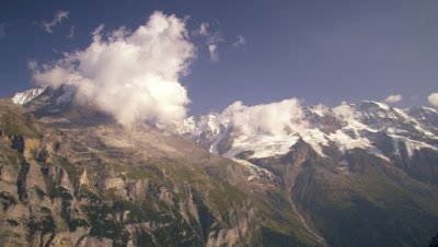 Dolly shot of the alps taken from an aerial tramway in Switzerland