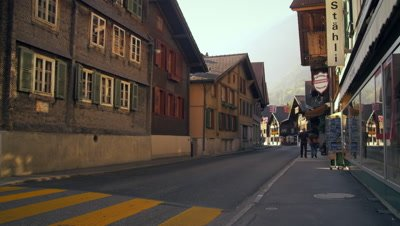 Cars traveling down Hauptstrasse road, Brienz, Switzerland