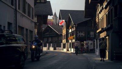 Twligiht footage of road and clock tower in Brienz, Switzerland
