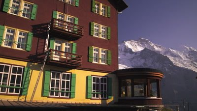 Close-up pan of the Hotel Bellevue Des Alpes and Mt. Eiger
