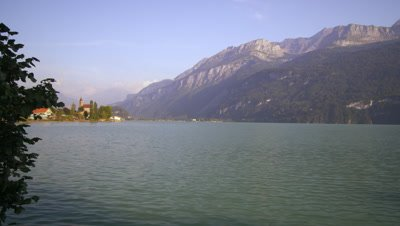 Panorama of Swiss lake, with mountains and houses