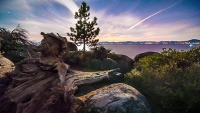 Time-lapse dolly shot of Lake Tahoe from Sand Harbor, Nevada. Desert sunset with lens flare seen.