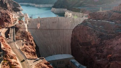 Timelapse aerial shot of the Hoover Dam in Nevada with lens flare