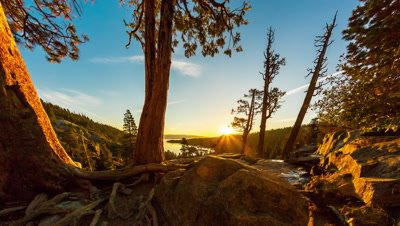 Tilting shot of the sunrise over Emerald Bay in Nevada with lens flare