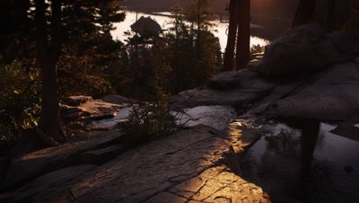 Dusk shot of stream surrounded by trees above Emerald Bay, Lake Tahoe, California.