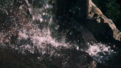 Slow motion closeup shot of waterfall splashing.
