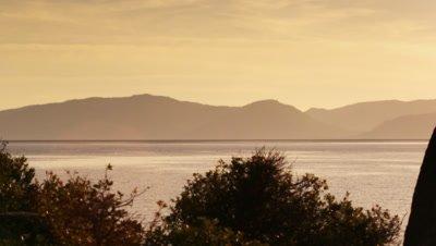 Static shot of sailboat and landscape. Shot at Emerald Bay State Park, Lake Tahoe, California.