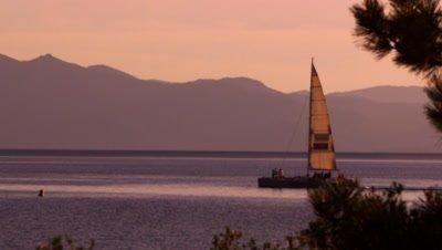 Sailboat at dusk. Shot at Emerald Bay State Park, Lake Tahoe, California