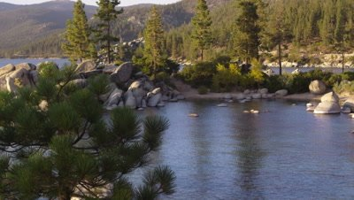 Static shot of Emerald Bay at Lake Tahoe, California, surrounded by rocks and trees