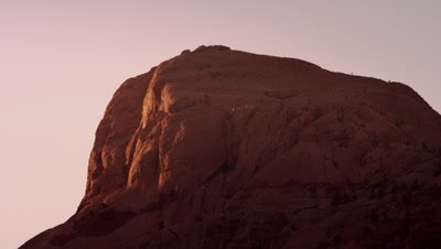 Sunset falling over red rock formation