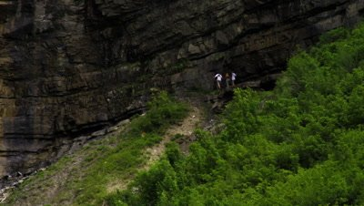 People walking at the base of Bridal Veil Falls in Provo, Utah.