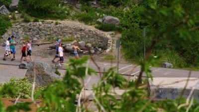 Teenagers walking along a path at Bridal Veil Falls in Provo, Utah.