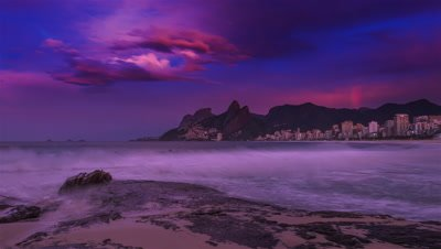 Time Lapse of sunrise at Arpoador Beach in Rio, Brazil.