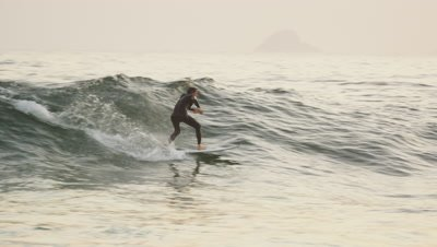 A man rides a wave in Guanabara Bay