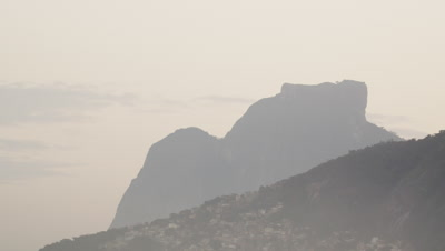 Pan shot of mountain and houses in Rio de Janeiro, Brazil.