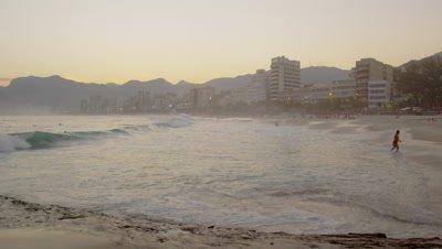 Slow motion pan from a beach in Rio de Janeiro to Atlantic Ocean.