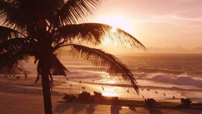 People on Ipanema beach at sunset