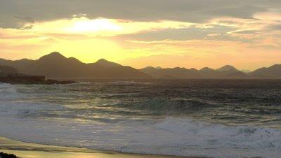 Waves breaking on Ipanema beach at sunset