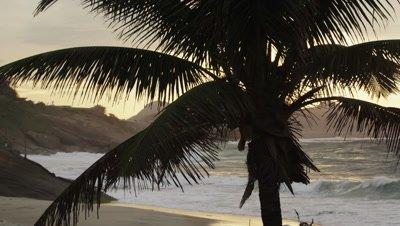 Slow panning shot of Ipanema beach at sunset