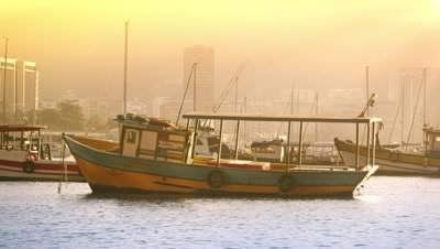 Static shot of a lone boat floating in Guanabara Bay.