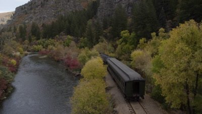 Train Rolling through Scenic Landscape