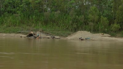 Tambopata river filming from boat
