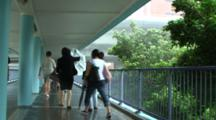 Wind And Rain Whip Through Elevated Walkway During Storm