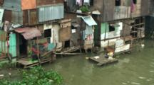 Slum Shanty Houses Line Polluted River In Manila