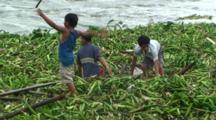 Children Retrieve Materials From Flood Water