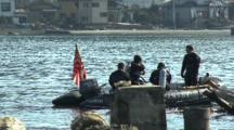 Navy Divers Search For Tsunami Victims In Kesennuma City Japan