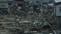 Japan Tsunami Aftermath - Survivors Walk Through Devastated Kesennuma City