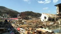 Japan Tsunami Aftermath - Man Sifts Through Debris In Kesennuma City