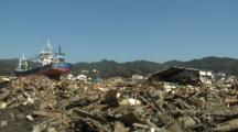 Japan Tsunami Aftermath - Large Ship Lies Amidst Burnt Wasteland In Kesennuma City