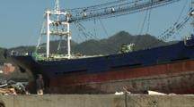 Japan Tsunami Aftermath - Man Walks Near Large Ship Washed Ashore In Kesennuma City