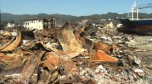 Japan Tsunami Aftermath - Wasteland Of Burnt Cars And Ship In Kesennuma City