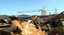 Japan Tsunami Aftermath - Ship Lies In Burnt Wasteland In Kesennuma City