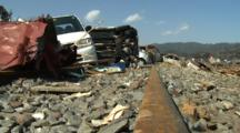 Japan Tsunami Aftermath - Wrecked Cars Block Railway Line In Kesennuma City