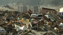 Japan Tsunami Aftermath - Heavy Equipment Works To Clear Remains Of Destroyed Rikuzentakata City