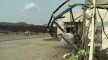 Japan Tsunami Aftermath - Helicopter Sits Near Damaged Hospital In Rikuzentakata City