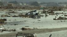 Japan Tsunami Aftermath - Debris Lies In Flood Water In Rikuzentakata City