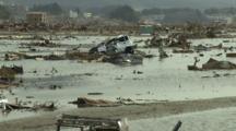 Japan Tsunami Aftermath - Debris Lies In Flood Water In Rikuzentakata City
