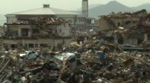 Japan Tsunami Aftermath - Rescue Crew In Remains Of Destroyed Rikuzentakata City