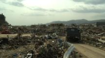 Japan Tsunami Aftermath - Military Truck Drives Through Carnage In Rikuzentakata City