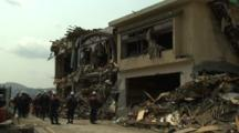 Japan Tsunami Aftermath - Rescue Team Outside Destroyed Building In Rikuzentakata City