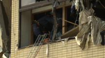 Japan Tsunami Aftermath - Rescue Team Retrieve Body From Destroyed Building In Rikuzentakata City