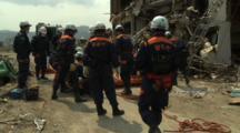 Japan Tsunami Aftermath - Rescue Team Attend To Dead Body In Rikuzentakata City