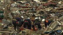 Japan Tsunami Aftermath - Rescue Crew Attend To Dead Body In Rikuzentakata City