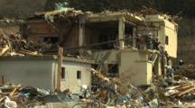 Japan Tsunami Aftermath - Rescue Crew Climb Off Destroyed Building In Rikuzentakata City